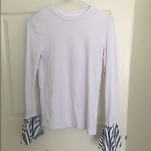 Tops - White shirt/sweater with blue ruffle cuff detail